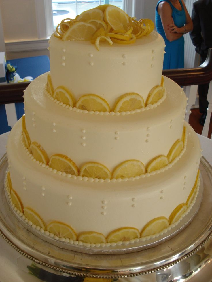 wedding cake photos with lemon slices and peach | lemon slices added a bit of whimsy to this cake by A Piece of Cake ...