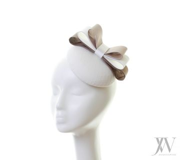 Hat:  Aoife is a beautiful ivory headpiece with a triple bow made from ivory and taupe silk fabrics.  ​ Bespoke option: This hat can be reproduced in different colours & sizes or using different materials.  As every individual headpiece is handmade by Jennifer, please expect slight variations to the picture.  Sales Enquiries: For bespoke hats or wholesale enquires, please contact our customer service team: Tel: +353 86 352 3692 Email: info@jenniferwrynne.com