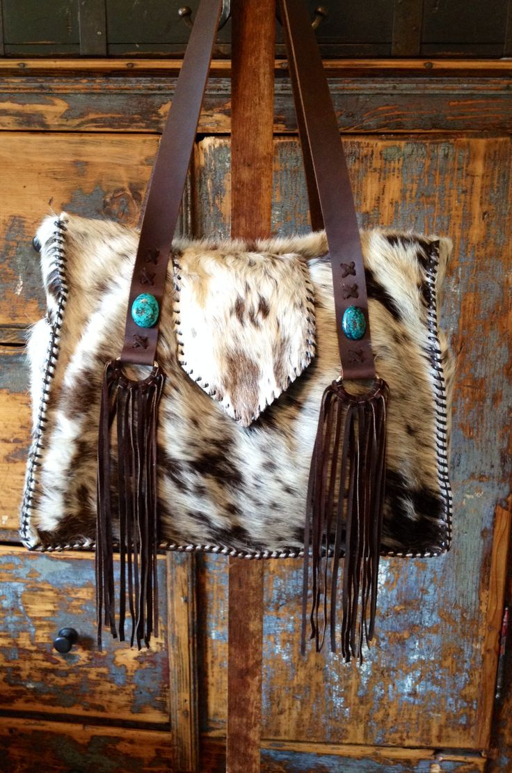One-of-a-kind, handcrafted, hair-on cowhide purses, totes, diaper bags, iPad cases, shoulder bags, clutches, and coin purses. Custom orders welcome.