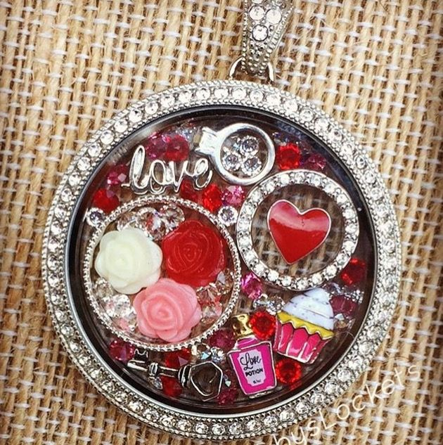 Big beautiful locket filled with Valentines Day red charms. Www.janicetarquin.origamiowl.com
