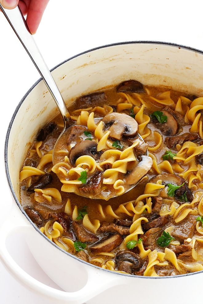 This Beef Stroganoff Soup recipe is easy to make, full of tender beef and noodles, and an absolutely delicious dinner!   gimmesomeoven.com