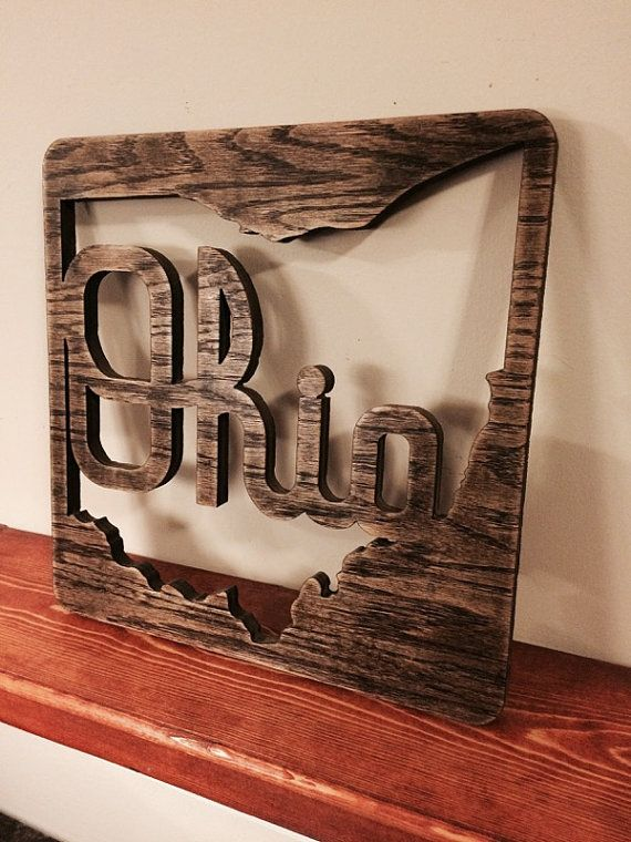 This Script Ohio wood wall decor, made from 1/2 thick oak plywood, is a unique way to display Ohio State pride. Each sign is precision cut in a