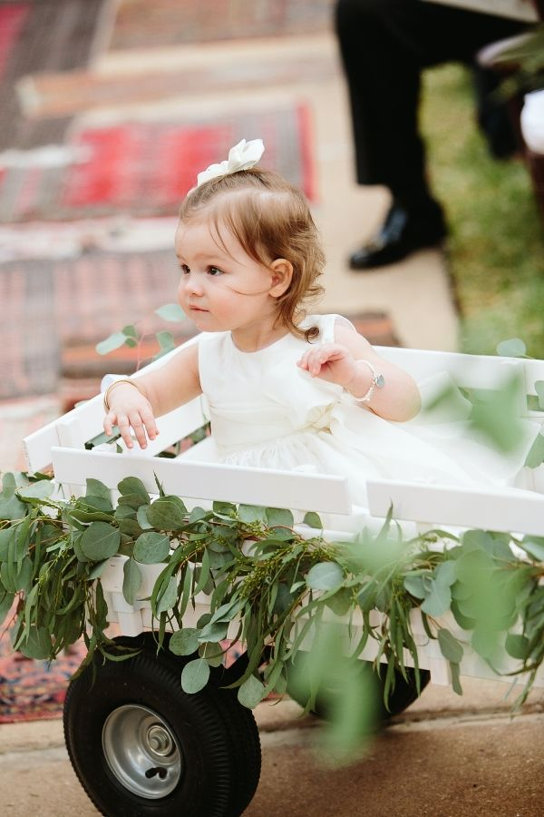 The sweetest flower girl wagon: http://www.stylemepretty.com/texas-weddings/austin/2016/05/10/she-lost-her-purse-at-a-concert-and-the-rest-is-history/ | Photography: SMS Photography - http://smsphotography.com/