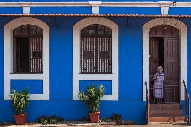 Woman at her doorstep in a typical Goan house in Panaji, Goa, India. by Marji Lang via flickr