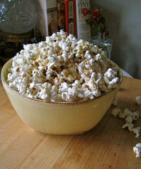Cheesy Spicy Popcorn  1 1/3 cups finely grated Parmigiano Reggiano, lightly packed  1/4 teaspoon cayenne, or more to taste  coarse salt  2 tablespoons olive oil  1/3 cup popcorn kernels  1/4 teaspoon cayenne, or more to taste  coarse salt