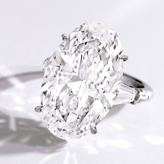 Sotheby's: Stunning Platinum-and-Diamond Ring: 14.78 carat oval with 1 carat tapered baguettes. Estimate $1.1milion  to $1.5 million