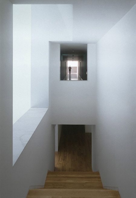 Staircase with daylight entering from the side. The Galician Centre for Contemporary Arts by Portugese architect Alvaro Siza.