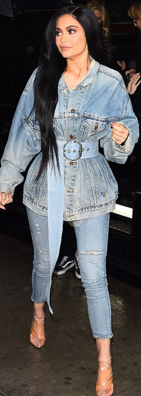 Who made Kylie Jenner's clear boots, skinny ripped jeans, and denim jacket?