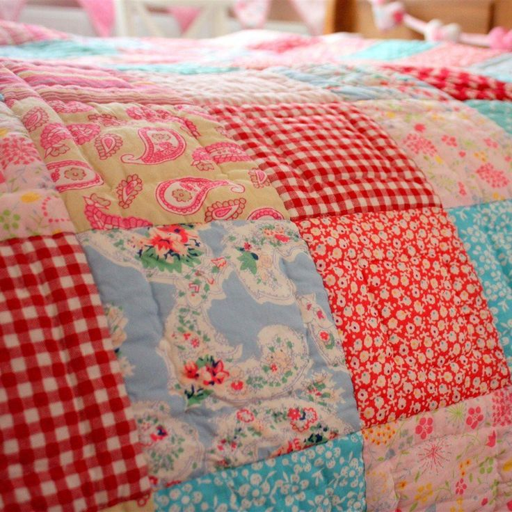 """This colorful patchwork quilt would be a beautiful addition to a girl's bedroom. - Hand Quilted 100% cotton - Quilt measures 68"""" x 86"""" - Sham measures approx. 20"""" x 30"""" - Includes quilt and one sham -"""