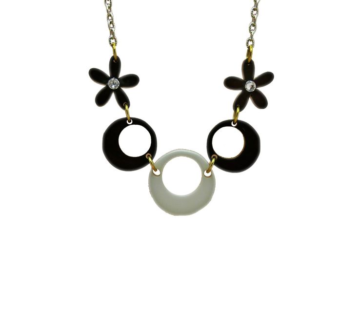 Quant Essential Monochrome Retro Daisy A Seventies 70s Retro floral mix Statement necklace Made with Swarovski Crystals & Perspex Comes on a Silver plated or Sterling silver Chain Chain length Approximately 16-18 inches Each charm size: (Approximately) 1 inch by 1 inch