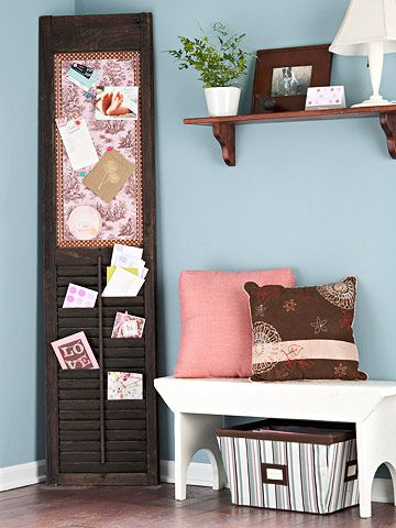 Create a mail center from an old shutter. To reuse a cast-off shutter, sand and paint or stain the piece deep brown. Remove the slats from the top half with a handsaw. Screw a piece of plywood over the back of the open area, then glue a layer of cork over the wood.