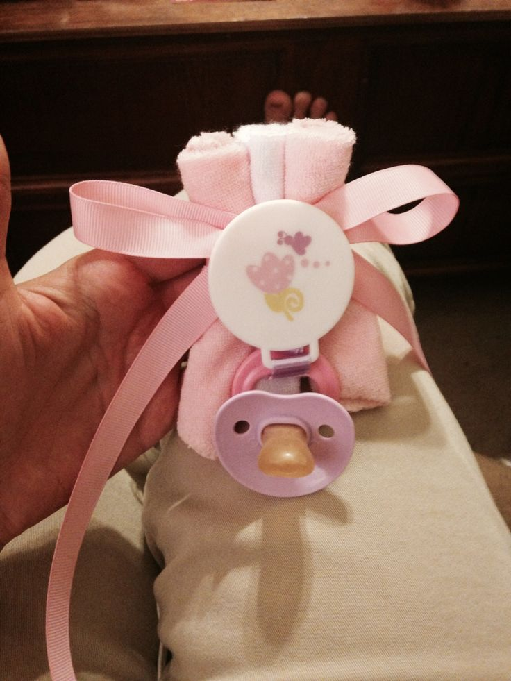 Easy no sew no glue baby shower corsage- washcloths, pacifier clip, pacifier, and ribbon! Safety pin on back!