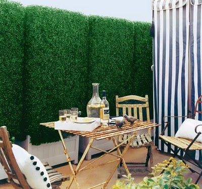 When I first saw this photo, I had no idea that this boxwood hedge is actually artificial boxwood. I think it looks great and wouldn't hesitate to use in it in a small space such as a concrete patio or a rooftop deck (properly secured!). In this case, the hedge hides an ugly chain link fence. What do you think?