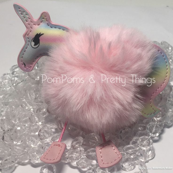 A personal favourite from my Etsy shop https://www.etsy.com/uk/listing/523488996/pompom-key-ring-pompom-bag-charm-unicorn