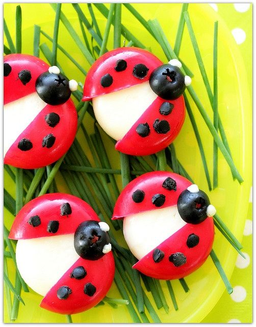 Lady Bug food art made with mini cheeses and a few other ingredients. So cute for spring and summer!