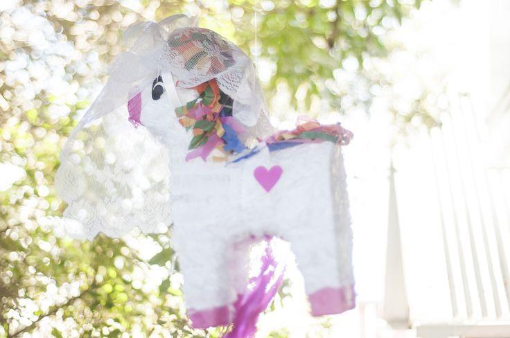 Unicorn Pinata with veil made of doilies
