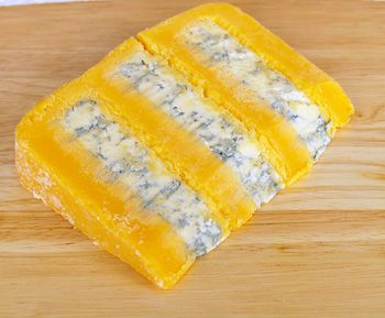 Huntsman Cheese is a Double Gloucester cheese with a layer of Stilton in the middle. It is sometimes made in 5 layers -- 3 of Double Gloucester and 2 of Stilton, and sometimes in 3 layers -- 2 of Double Gloucester and 1 of Stilton. One of my all time favorites.