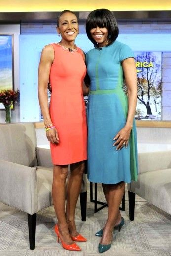 Robin Roberts poses with First Lady Michelle Obama during a taping of Good Morning America, in New York City.