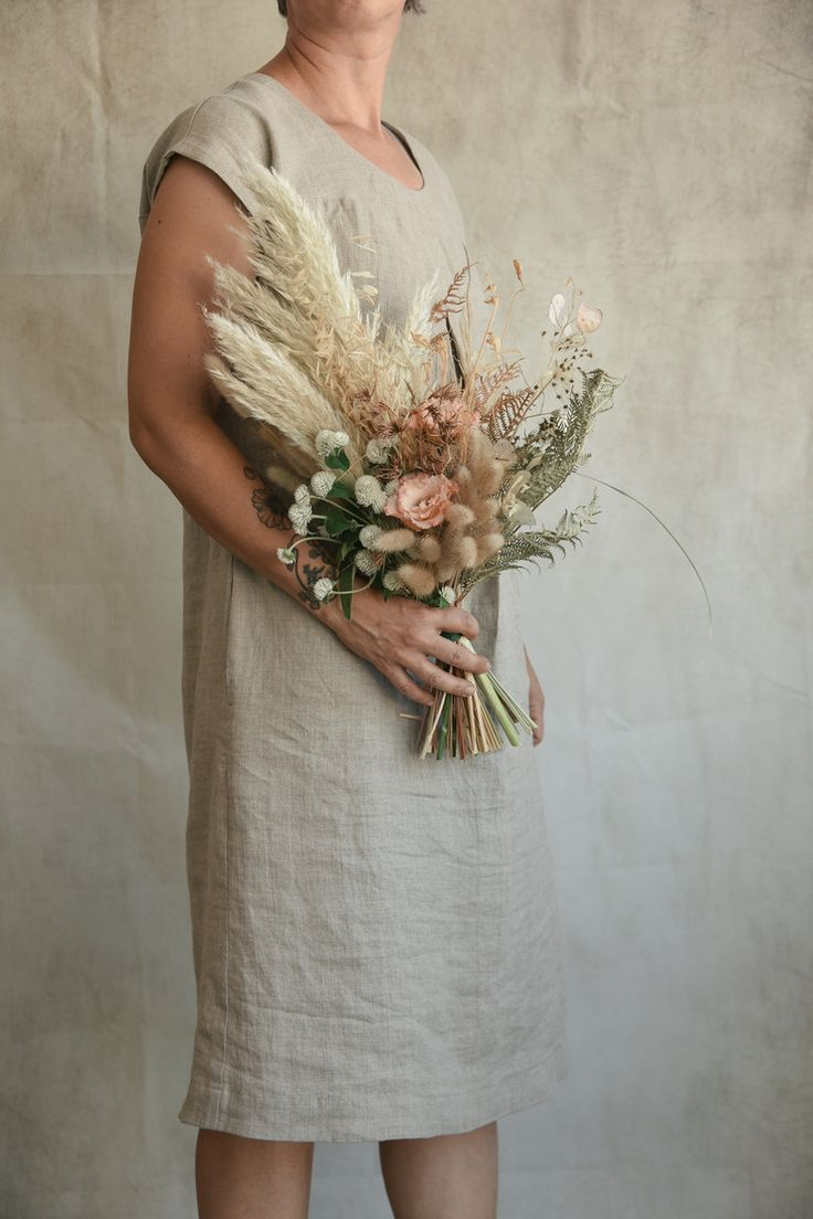 Carmen and Daniel's Beach and Winery Wedding Autumn colours, peach, apricot, pastels, dahlias, dried grasses, pampas, ceremony circle, hanging florals, bridal backdrop, vintage