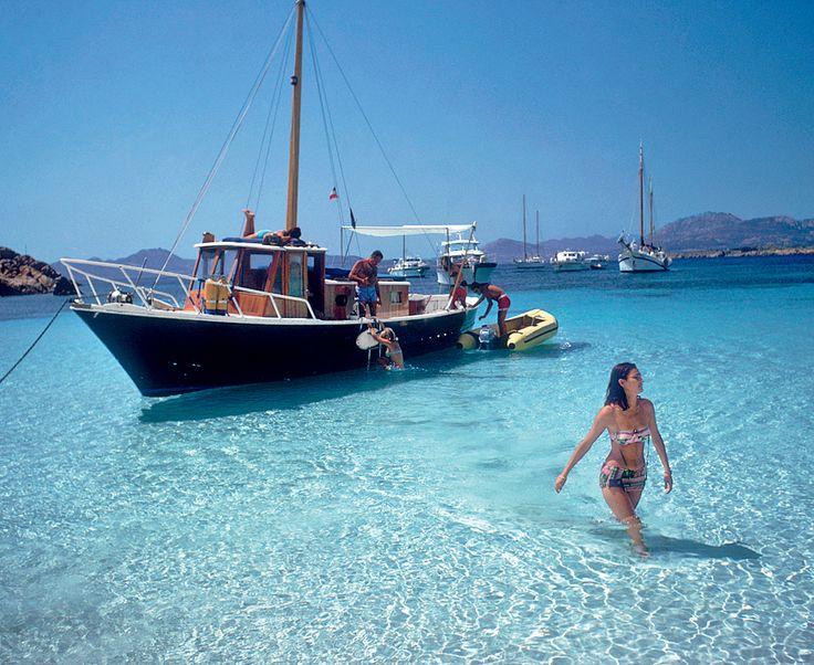 Model Selvaggia Borromeo d'Adda comes ashore in Costa Smeralda, Sardina, Italy, 1967 by Slim Aarons.