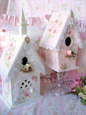 A painted wooden birdhouse perched on top of a class candleholder. Pretty DIY