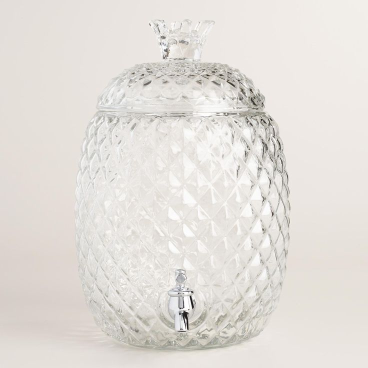 Crafted of glass with an embossed design that captures a pineapple's unique texture, our exclusive beverage dispenser adds a tropical feel when entertaining - why not turn your party into a luau? www.worldmarket.com #CelebrateOutdoors