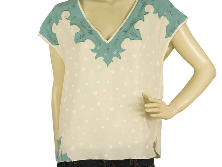 This Zadig & Voltaire Deluxe top with it's amazing style is here to steal your heart. With 100% silk fabric in white with light blue details and ohh so many stars , cap sleeve style and deep V neckline is such an elegant piece !!