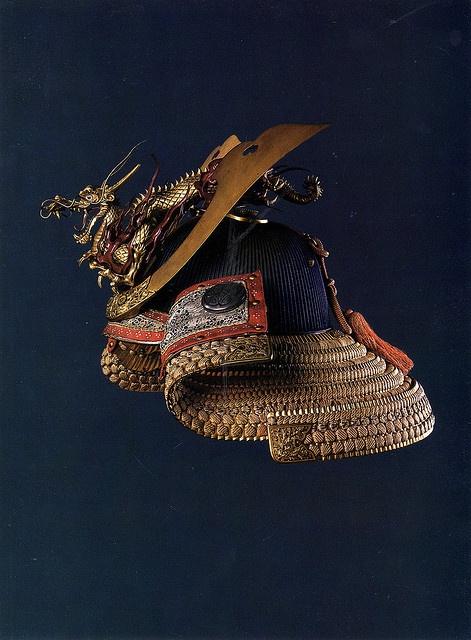Japan - Helmet  HELMET 18th century Iron, lacquer, wood Height 26.2 cm Depth 39.5 cm Dragon ornament length 33.5 cm; height 15 cm Loaned by the Center for Japanese Studies, University of Hawaii.