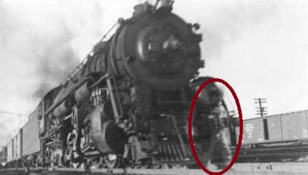 The story behind this eerie pic is that a boy died on the tracks and now appears in this image. Can you see the small figure standing in front of the train?