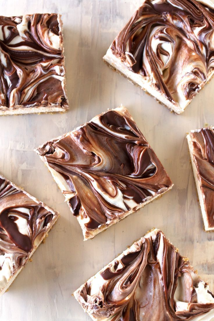 Light and fluffy cheesecake swirled with creamy Nutella sits on top of a graham cracker crust. Your tastebuds will swoon over these No Bake Nutella Swirl Cheesecake Bars.