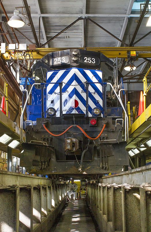 Annual inspection - Montana Rail Link Electrician Steve Howes inspects the traction motor brushes on MRL SD40-2XR no. 253. The 253 is in the MRL's running repair facility (also called the roundhouse by employees) in Livingston, Montana, for its annual inspection.