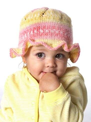 Free Pattern - Sweet #knit cap features a pretty ruffle around the brim.