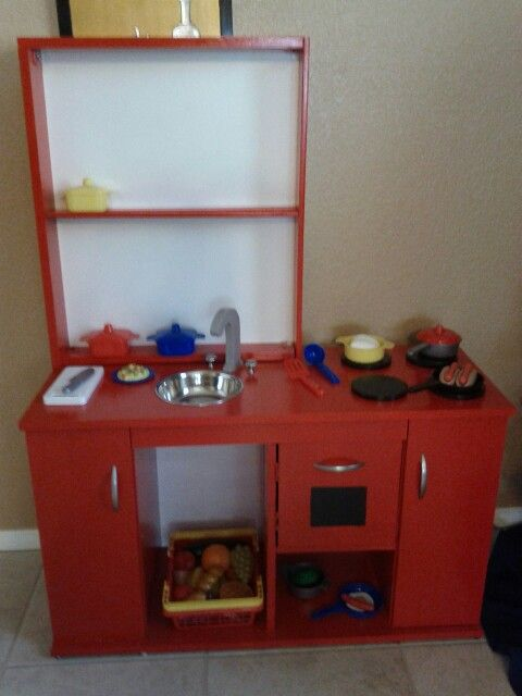 DIY kids play kitchen from a repurposed TV stand entertainment center.
