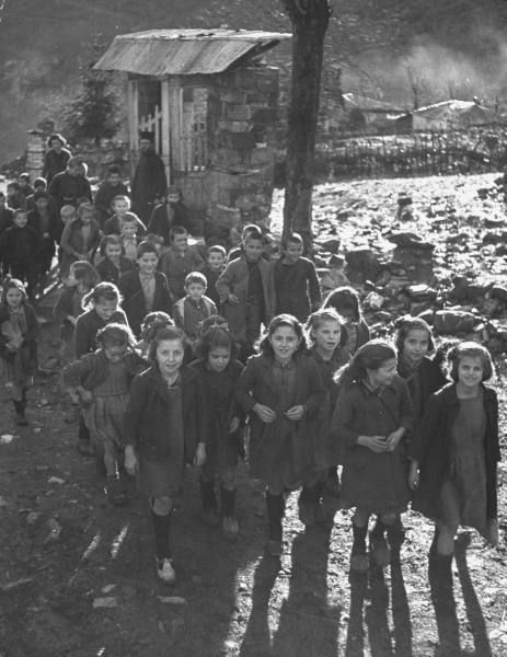 Civil War/Greece Kids arriving at the new school built on the loft in the church.Location:Louzesti, Greece Date taken:December 1947 Photographer:John Phillips