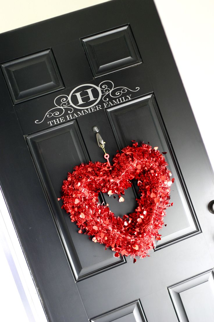 Black door with monogram - I think I would do the monogram on the inside of the door for a bit more privacy