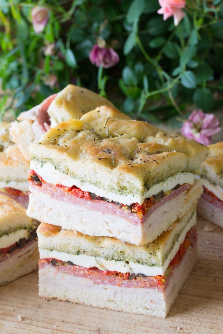 Pressed Italian Picnic Sandwiches are the perfect upscale sandwich for picnics, brunches, and baby showers. It's a fancy sandwich that packs a flavorful punch!