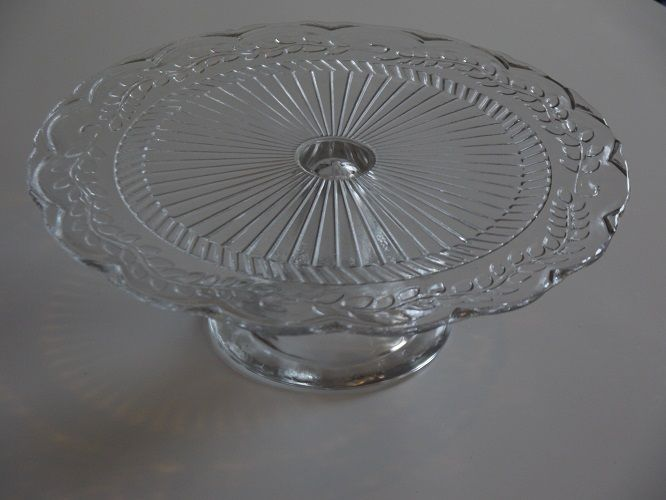 Vintage Clear Glass Cake Stand. Wedding tableware and decorations available to hire in Kent, UK. Please see www.picketfenceweddings.co.uk for further information and prices.