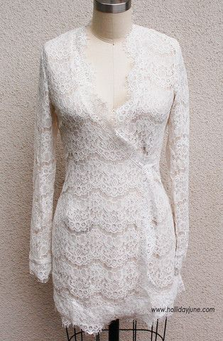 95c15090500693 Gorgeous little lacy wrap dress by Olivaceous. Off white lace with fringe  trim and a nude mesh underlay.