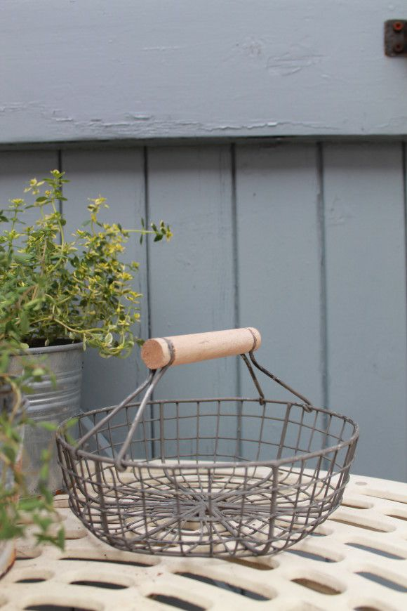 Round Wire Basket This delightful circular basket in distressed grey, has a sweet wooden handle and is a handy and attractive addition to your kitchen and the perfect place to store your eggs. £8.95