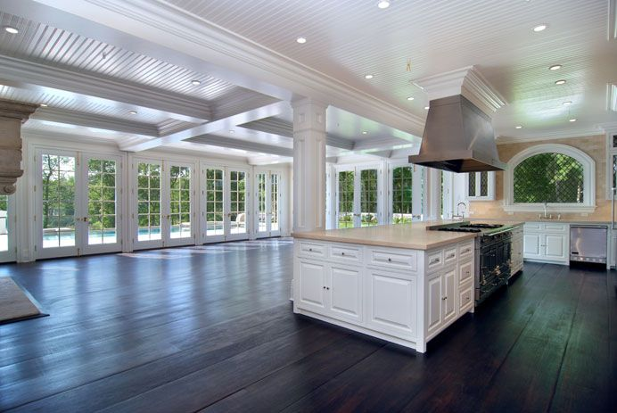 This is what I want for the open plan kitchen/dining/living area - the dark floors, the island, lots of space and light. (note: we won't have stove on the island, or the small sqaure window style).