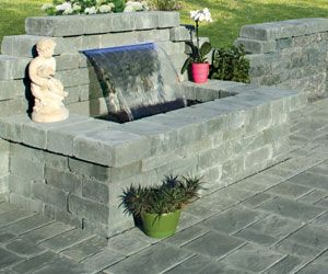 Add the peaceful sound of a pondless water feature to your backyard patio.