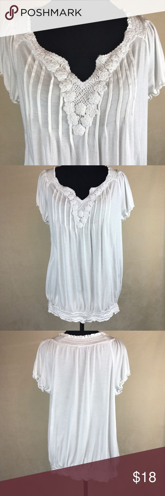 """Lane Bryant white peasant blouse top Lane Bryant women's size 14 16 peasant blouse in white. Floral embroidery type designs at neckline. V neck. Gently used. No flaws. Measurements while laying flat are armpit to armpit: 21"""" length: 26"""". Lane Bryant Tops Blouses"""