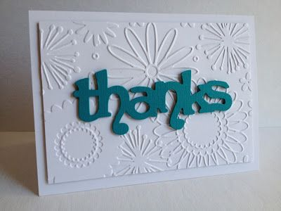 Used a cool embossing folder I bought at AC Moores a couple months ago...thought it was so pretty and perfect with something very simple in front of it....like this Sizzix sentiment(Phrases, Thanks). The folder is made by Darice and is called Flower Frenzy and is 5 x 7...so a wonderfully large folder to fit an entire A2 card if you like:)!!