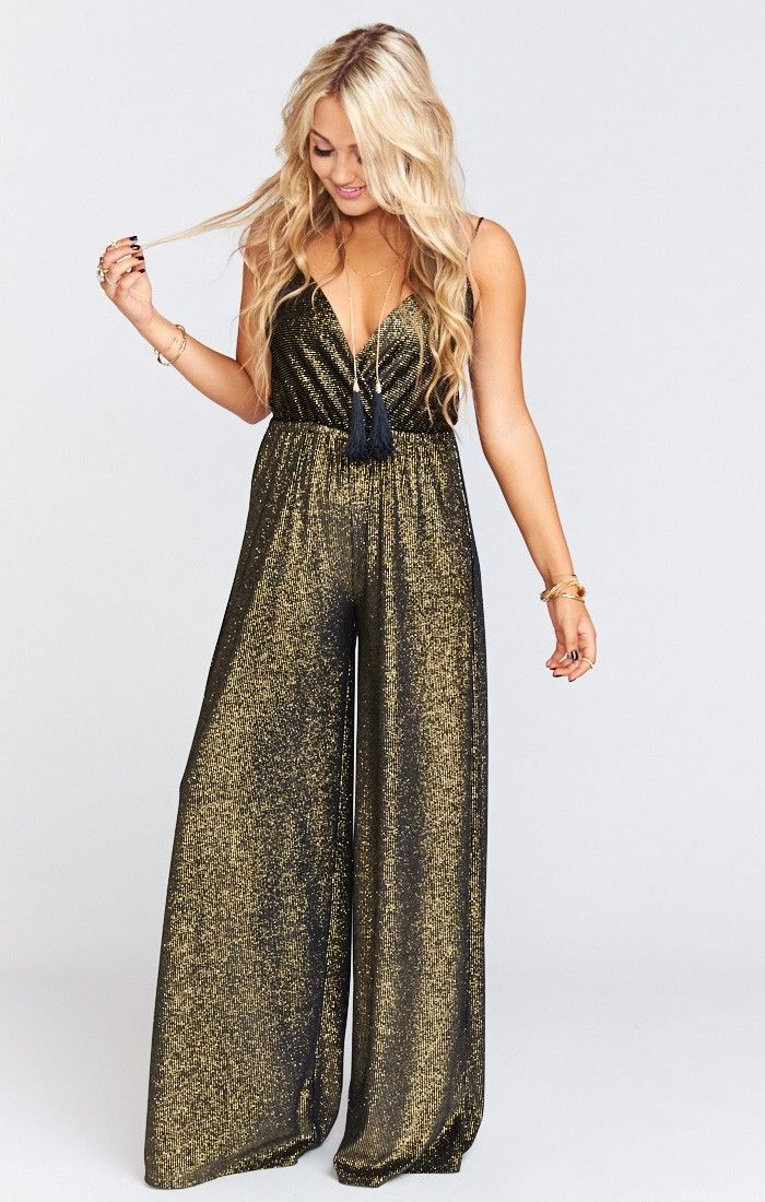 Girl you will be Rolling in hot in the Jagger Jumpsuit!  Flattering criss-cross top, high elastic waist and a wide leg never let you down.  Time to reign as disco queen ladies!   *MADE IN THE GORGE USA*					 *90% Polyester, 10% Spandex				 *Ajustable Straps  *Wide Leg *Elastic Waist 				 *Basically Wrinkle-proof.  Throw in purse for later recommended
