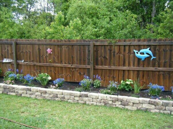 Flower bed along fence