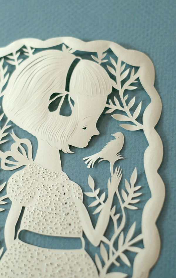 This beautiful papercut is sold out, but it's a sample of Elsa Mora's works; she has an etsy shop