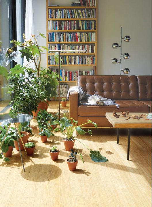 EQ3 Lifestyle Imagery: 2012 Fall Catalogue. Featured here, Reveire Sofa in leather, Reclaimed Teak Coffee Table, Six Globe floor lamp, Pablo Brazo Floor Lamp, Taaj End Table