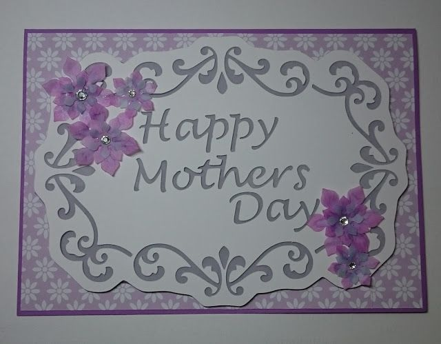 Mother's Day, purple and white..MerryMade Cards & Crafts... I found the lovely daisy patterned paper for the background.  Again put vellum behind the die cut and then layered that on purple card stock which I hand cut to shape.  I punched out plain vellum flowers and then coloured wiht copic pens to match the papers.