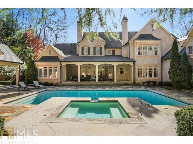 Live a life of complete luxury in this home! Gorgeous backyard with resort style pool, Gentleman's Library, and so much more.   https://loom.ly/_mPuhhY  #thedavidsonteam #pool #mansionmonday