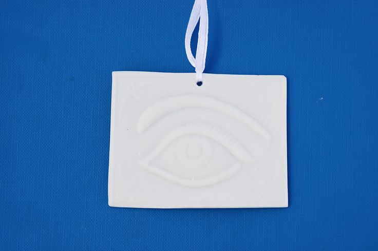 Handmade porcelain evil eye hanging. Www.Etsy.com/shop/WillyaCollection